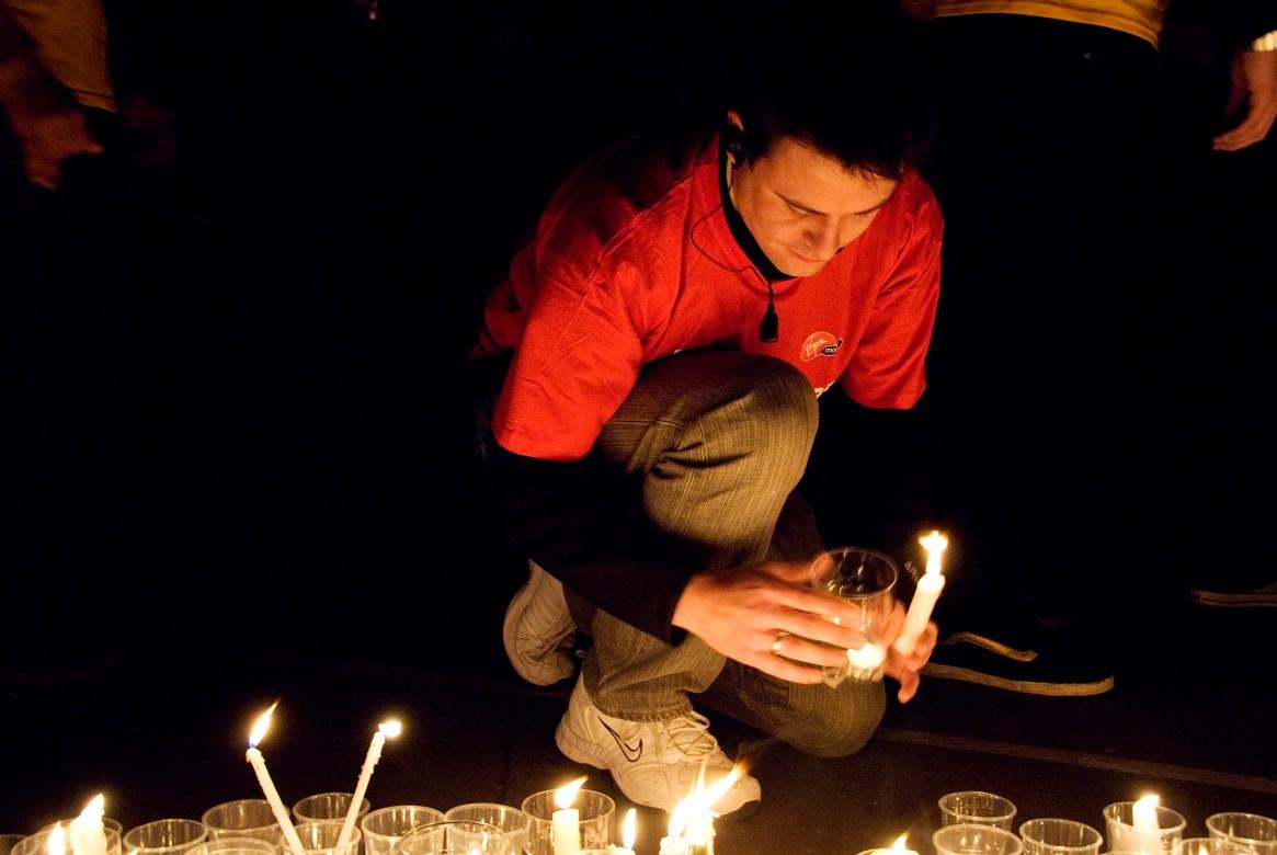Man placing candle