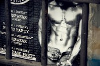 Poster showing man's naked muscly torso