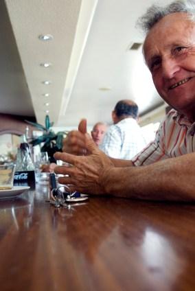 Old man at a bar counter