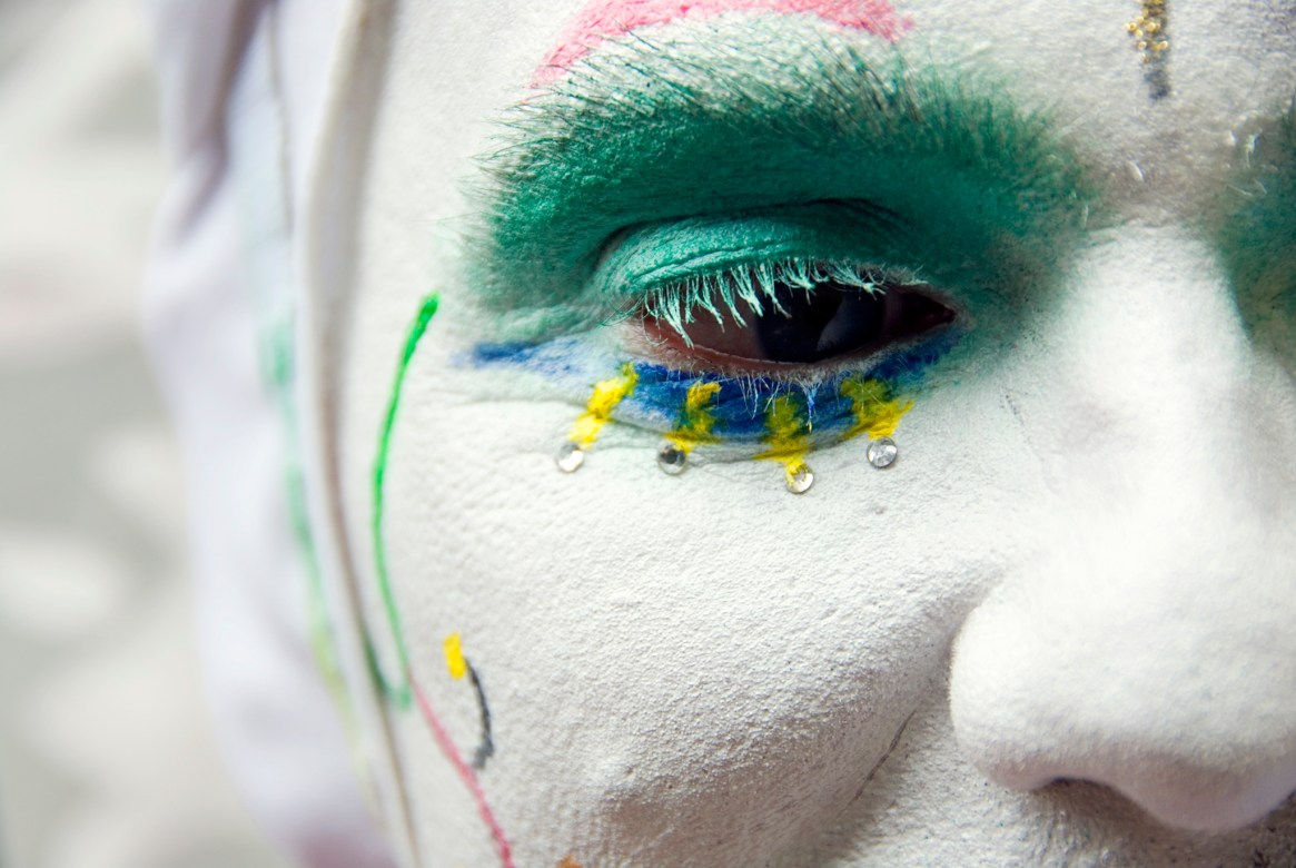 Close-up of a member of the Sisters of Perpetual Indulgence, showing her colourful face and eye makeup