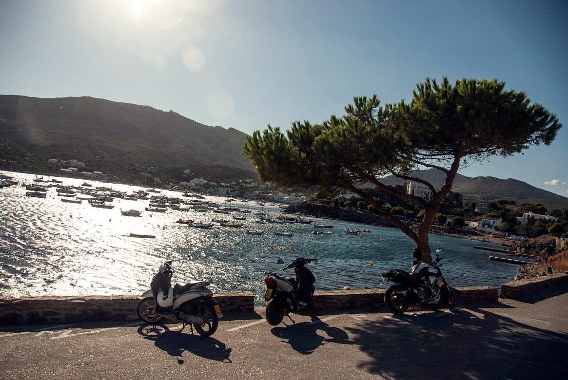 Mopeds parked alongside the beach in the late afternoon, Cadaqués, Spain