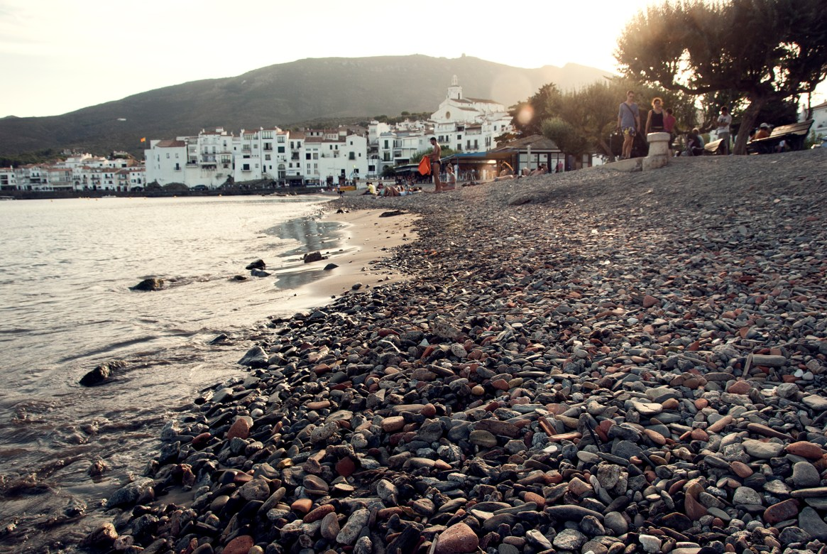 Sunset over the pebbled beach in Cadaqués, Spain