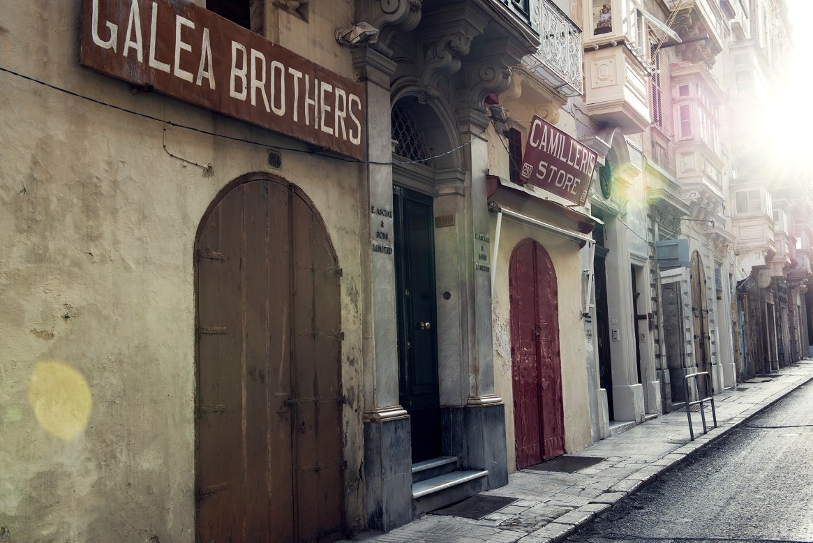 A row of old, independent family stores in Valetta's old town, Malta