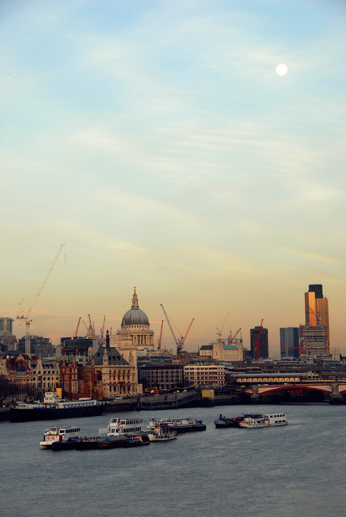 The City of London viewed from the River Thames at sunset