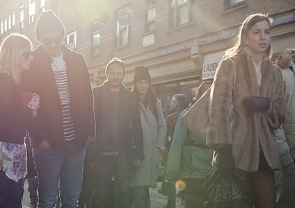 Mixed Crowd walking down Brick Lane on a sunny afternoon