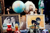 Antique street stall selling kitch paintings, candles, stuffed toys and a globe