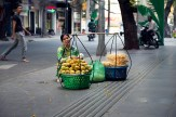 Woman selling mangoes and other fruit on the street in Ho Chi Minh City