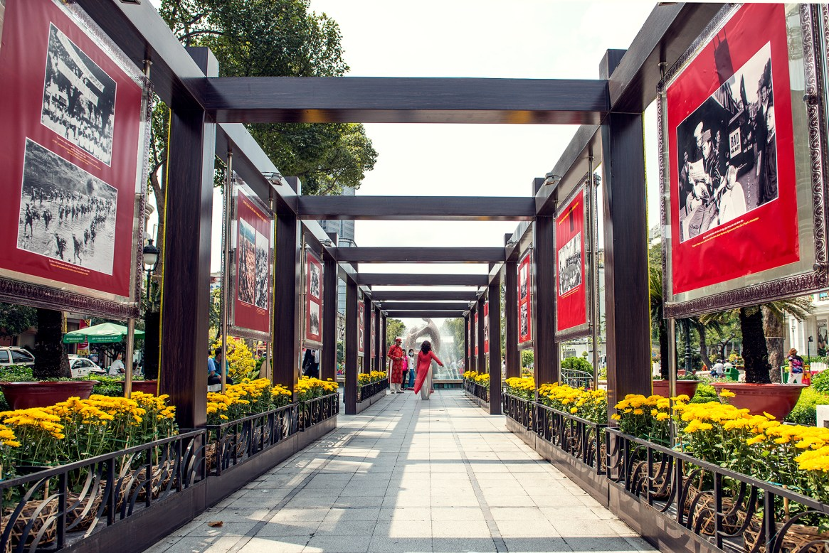 Installation with red propaganda posters and yellow flowers