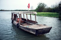 Traditional wooden boat on the river in Ho Chi Minh City