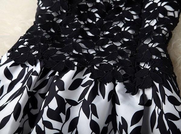 detaliu zona de mijloc rochie seara din dantela aplica in alb si negru