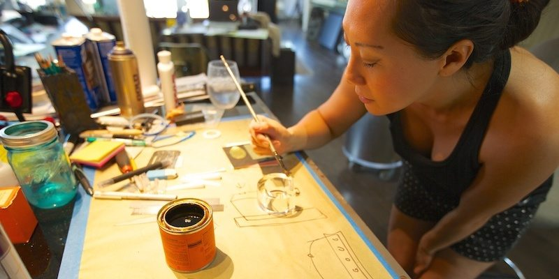 Stefanie Phan in the workshop creating the On The Money gold and acrylic cuff