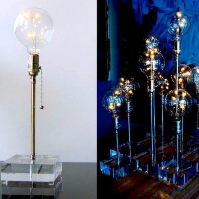 """These Firefly lamps emanate the most romantic glow with its five-incandescant LED-lights 'flying' like fireflies in a large bare bulb."" From $204 with the 15% discount."