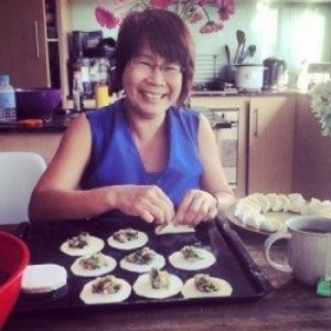 My mom, Jo Phan, making dumplings with my sister, Tiffany, in Melbourne, Australia.