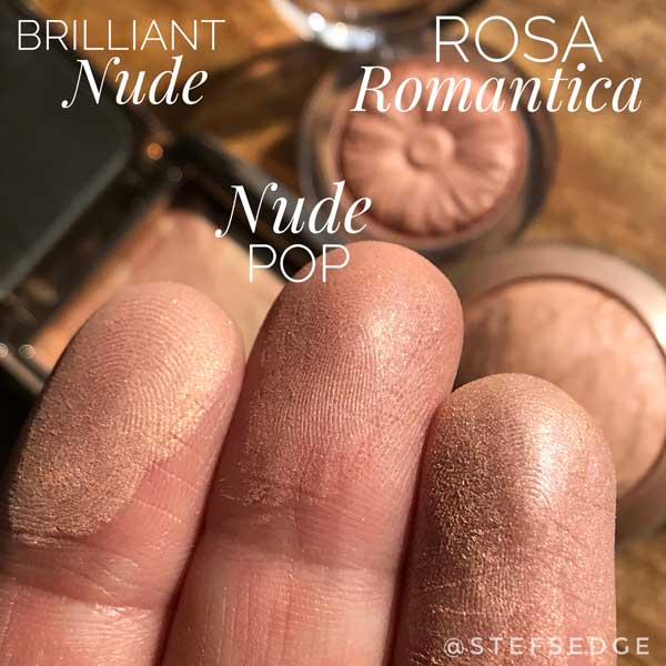 Fingertip swatches of Hourglass Brilliant Nude Blush, Clinique Nude Pop blush, and Milani Rosa Romantica baked blush
