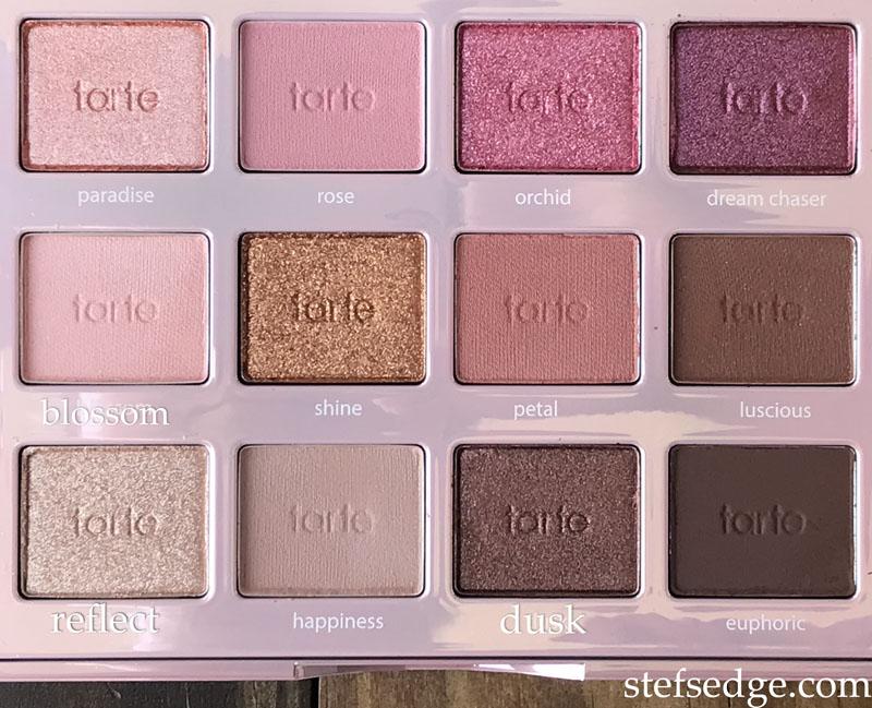 Tarte Tartelette Juicy palette inside, close up of the eyeshadow pans. Pinks, purples, browns.
