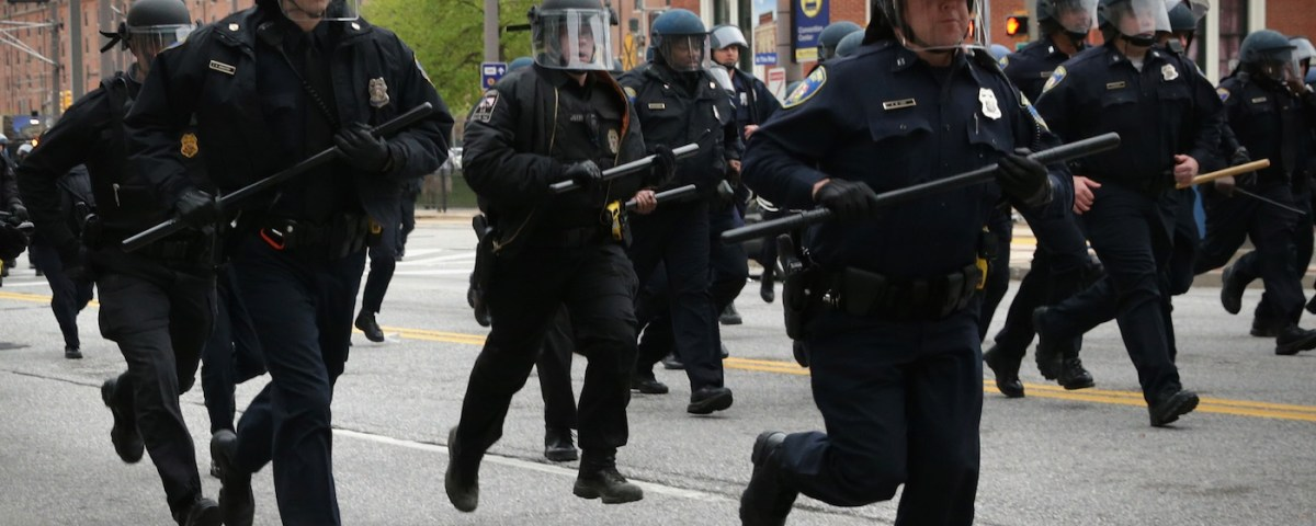BALTIMORE, MD - APRIL 25: Police in riot gear charge as they try to push protesters away during a march in honor of Freddie Gray on April 25, 2015 in Baltimore, Maryland. Gray, 25, was arrested for possessing a switch blade knife outside the Gilmor Homes housing project on Baltimore's west side on April 12. According to his attorney, Gray died a week later in the hospital from a severe spinal cord injury he received while in police custody. (Photo by Alex Wong/Getty Images)