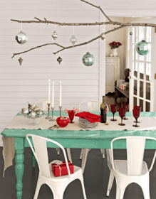 Christmas holiday table decor chandelier - tree branch chandelier and turquoise table with white metal chairs - holiday design and decor - interior design