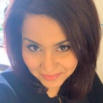 Image of Dr Rasha Gadelrab looking into the camera.