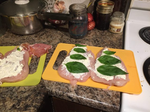 keto-friendly stuffed chicken breast, spread cream cheese and add basil leaves