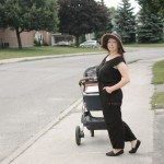 thrill of the thrift bought new black romper jumper mom pushing uppababy stroller with itzy ritzy caddy
