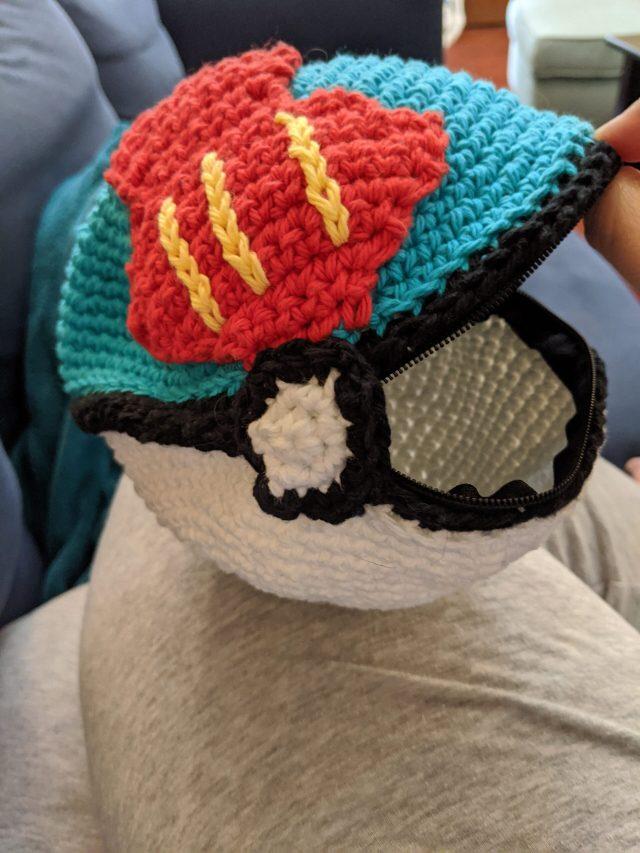 A crochet pokeball zipper bag