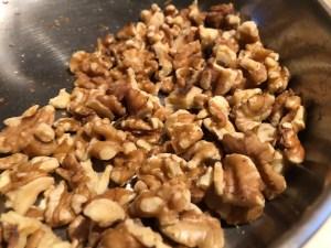 walnut halves in a pan