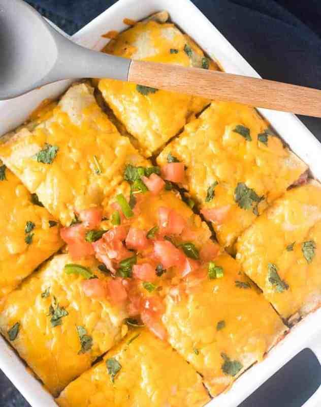 Taco Casserole garnished with chopped tomatoes, jalapeno, & cilantro.