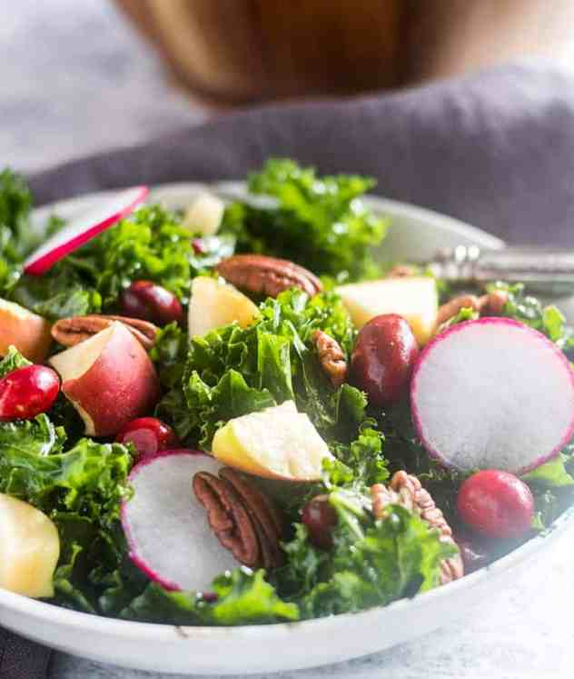 Apple Kale Cranberry Salad in a bowl.