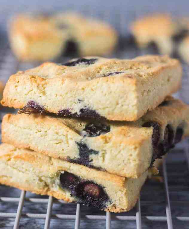 Blueberry Scones stacked on a cooling rack