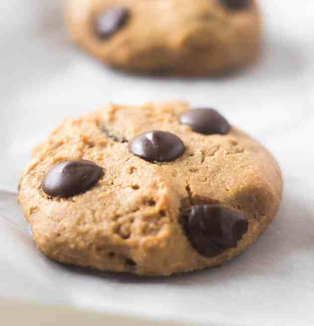 Coconut Flour Chocolate Chip Cookie on a baking pan lined with parchment paper.