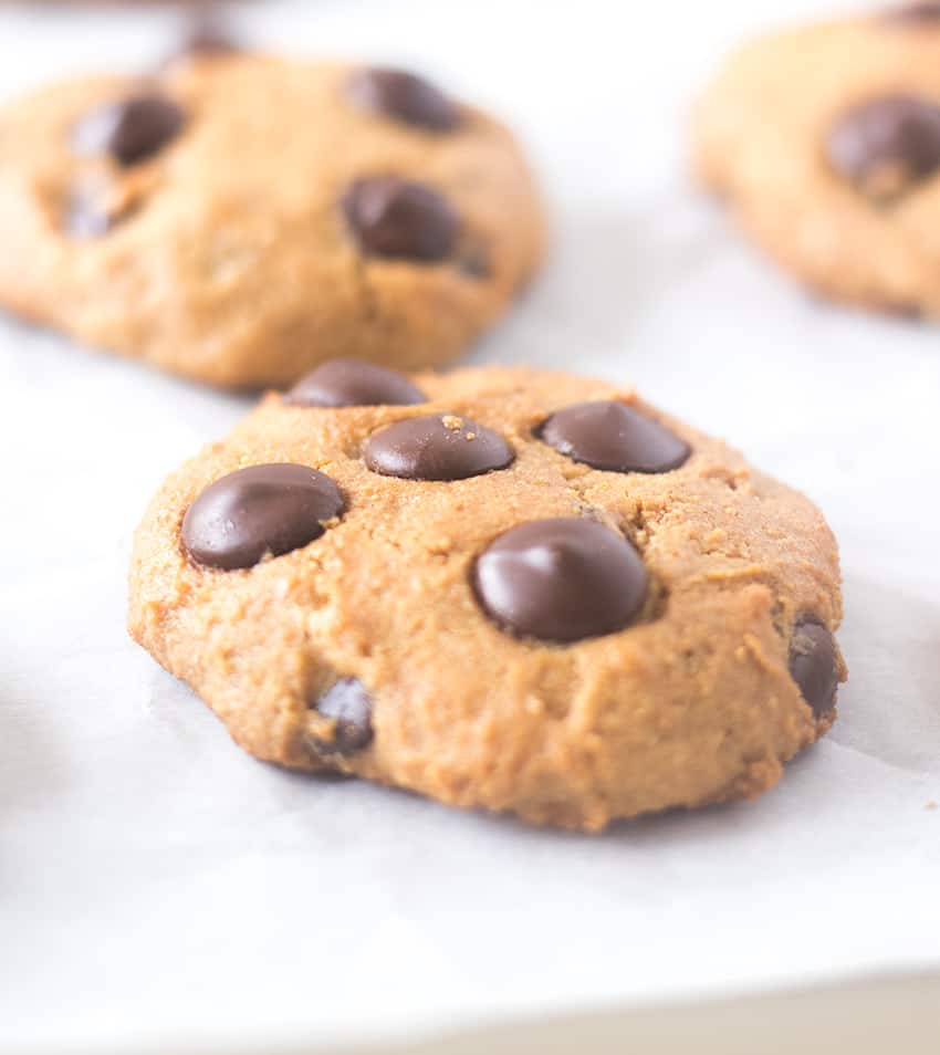 Cookies on a baking pan lined with parchment paper.
