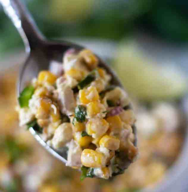 Mexican Street Corn Salad on a spoon.