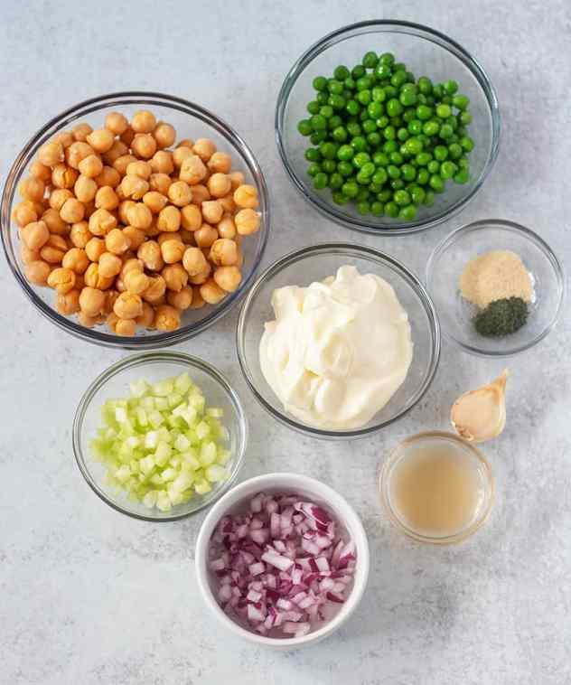 Chickpeas, Green peas, celery, red onion, mayo, ACV, garlic, seasonings.