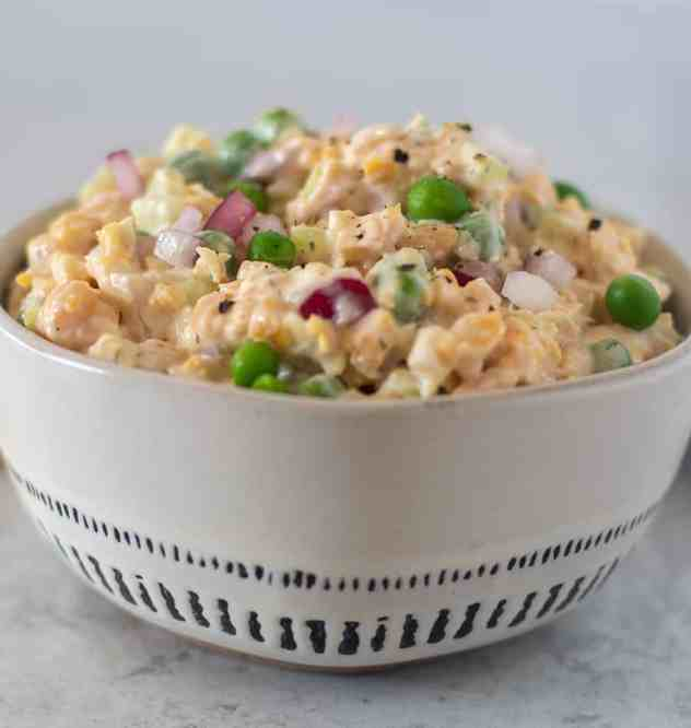 Chickpea salad in white bowl.