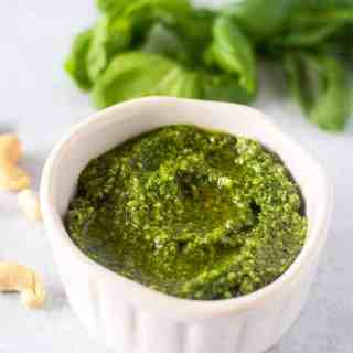 basil pesto in a white bowl