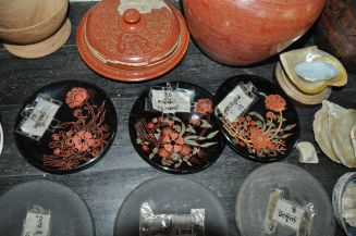 different stages of the lacquerware process, cheap broken items on the top