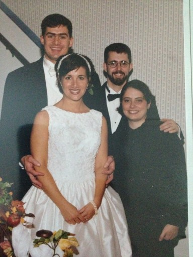 Our best man and wife along with us at our wedding...and sporting the Princess Di haircut.