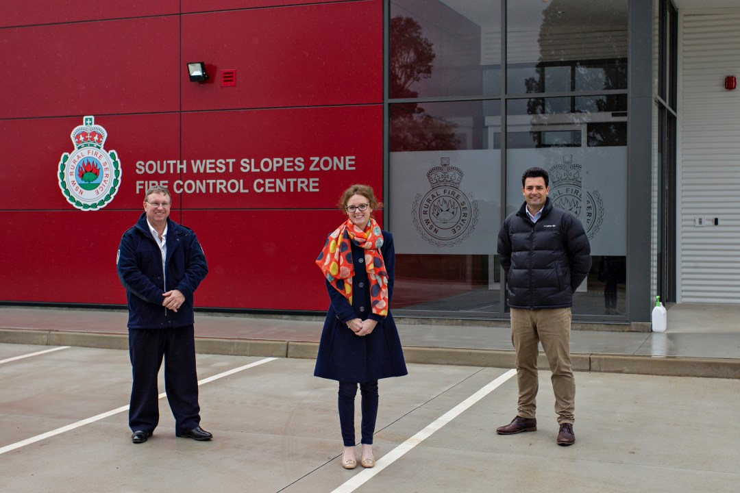 Inspector Tom McDevitt, Steph Cooke MP and Darren Hession from PWA and Zauner Constructions stand in front of the new RFS buildings.