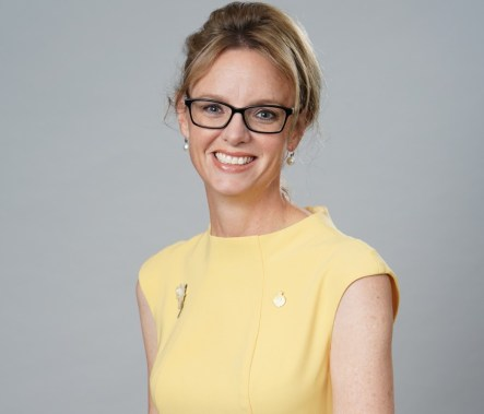 Steph Cooke MP Member for Cootamundra smiles wearing a lemon yellow dress (headshot)