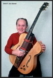 "Les Paul with his original solid body electric guitar ""The Log"" (built in 1940)"