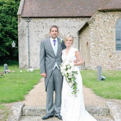 Norfolk wedding photographer – bride and groom outside church