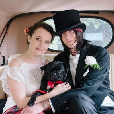 Norfolk wedding photographer – bride and groom in wedding car with pug