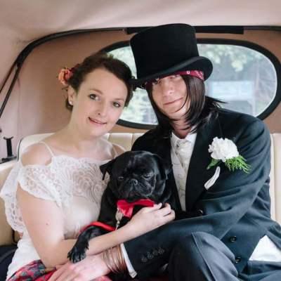 Norfolk wedding photographer – bride and groom in wedding car with pug