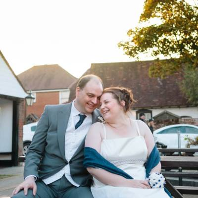Norfolk wedding photographer – bride and groom sitting in sun