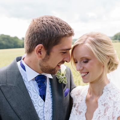 Norfolk wedding photographer – bride and groom hay field