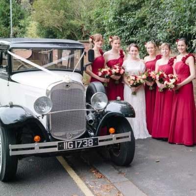 Norfolk wedding photographer – bridal party with wedding car