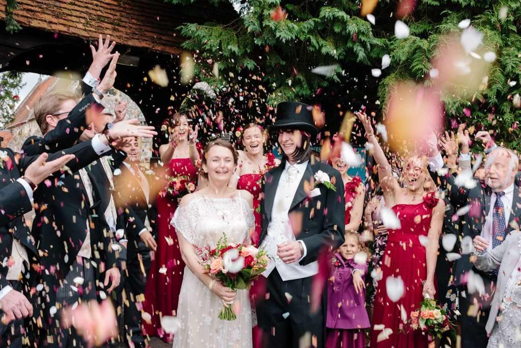 Norfolk wedding photographer – bride and groom confetti