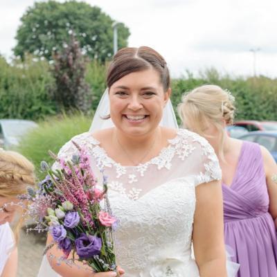 Norfolk wedding photographer – bride with bouquet