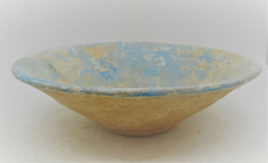 Earthenware bowls covered with a bright blue slip