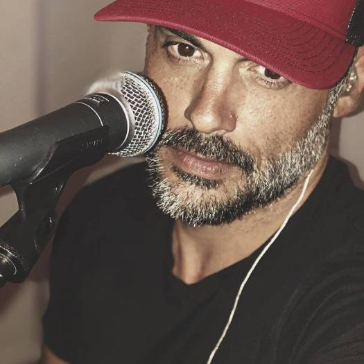 Stephen Martines with Microphone and Hat